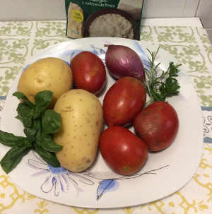 Baked_potatoes_and_onions_with_tomatoes_and_pecorinocheese_ingredients