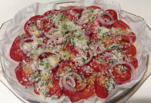 Baked_potatoes_and_onions_with_tomatoes_and_pecorinocheese_ready_to_bake